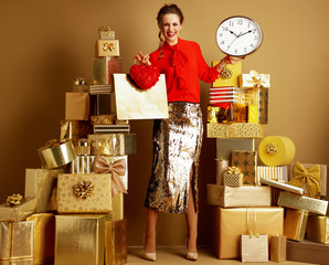 shopper woman with shopping bag and red heart showing clock