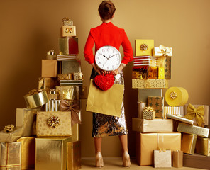 stylish shopper woman with shopping bag, red heart and clock