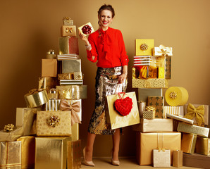 fashion-monger with shopping bag and red heart showing gift card