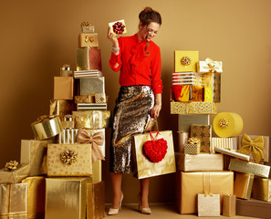 woman with shopping bag, red heart and gift card or Valentine's