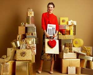 woman with shopping bag, red heart and big white calculator