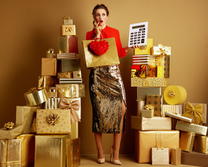 shopper woman with shopping bag, red heart and big white calcula