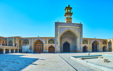Panorama with clock tower portal of Seyed Mosque, Isfahan, Iran