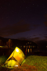 Camping by fjord in the night