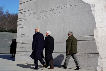 U.S. President Donald Trump and U.S. Vice President Mike Pence depart after placing a wreath at the Martin Luther King Memorial in Washington