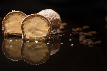 candies chocolate filled (coconut flavor, cream). food background. top view