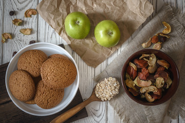 Wholesome breakfast.  Homemade oatmeal cookies, apples and dried fruits.