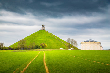 Famous Lion's Mound memorial site at the battlefield of Waterloo with dark clouds, Belgium Wall mural