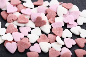 Heart shaped sprinkles on black background