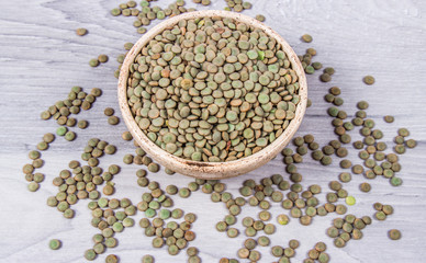 Green lentils - legume seeds with a high content of vegetable protein. Conception of healthy eating.
