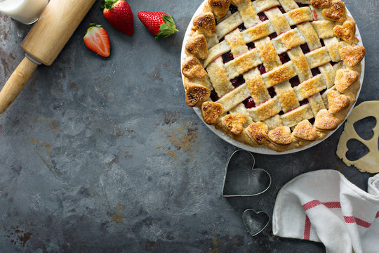 Strawberry pie with lattice and heart shaped decoration for Valentines Day