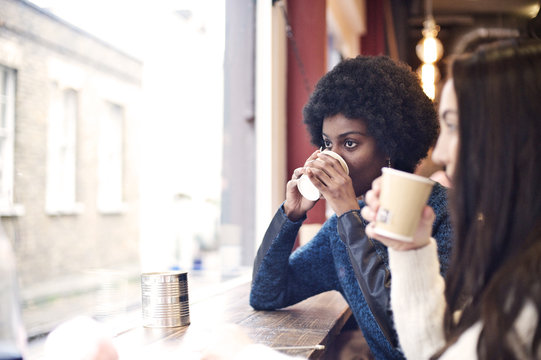 Young black woman and caucasian woman in a cafe