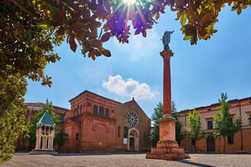 View of the basilica of San Domenico in Bologna Italy with solar flare