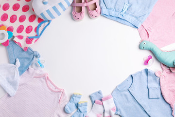 Composition with cute clothes and space for text on white background, flat lay. Baby accessories