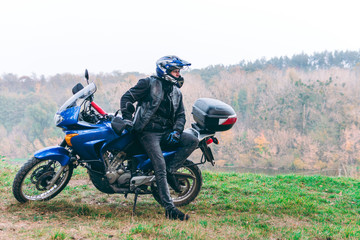 Motorcyclist on off road, enduro, extreme sport, active lifestyle, adventure touring concept, enduro outdoor