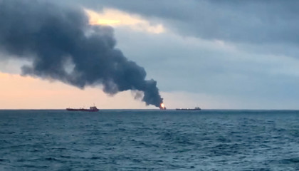 Smoke rises from a fire at a ship in the Kerch Strait near Crimea