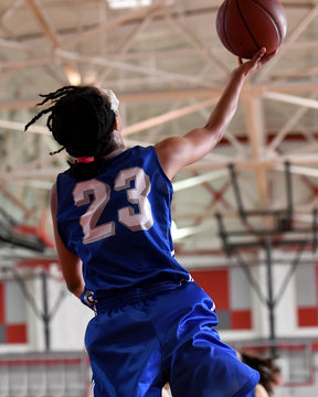 High School athlete making a layup during a basketball game