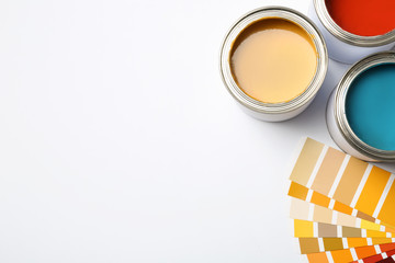 Paint cans and color palette on white background, top view. Space for text Wall mural