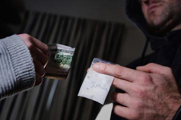 drug trafficking, crime, addiction and sale concept - close up of addict buying dose from drug dealer