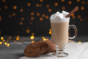 coffee with marshmallows and chocolate cookies with lights