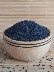 Black sesame in a wooden bowl.
