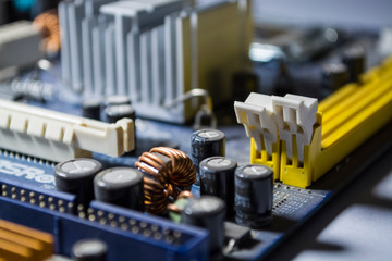 The old motherboard from the personal computer and its volume details. Dust. Repair of the computer. Modern technologies.