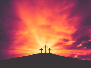 Three Christian Easter Crosses on Hill of Calvary with Colorful Clouds in Sky - Crucifixion of Jesus Christ