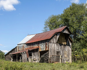 Aging barn and hayloft in a rural area.