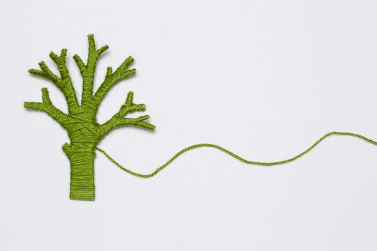 green yarn tree isolated on white. Eco concept