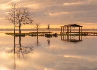Pier on a Minneola lake at sunrise