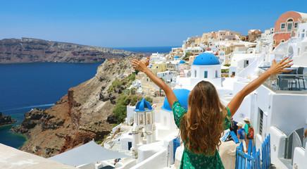 Traveler girl enjoying Santorini view with open arms