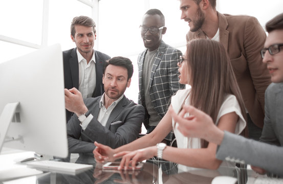 business team looking at desktop monitor is waiting for online result