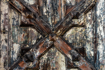 texture of old paint on wooden boards, decorated with wooden cross