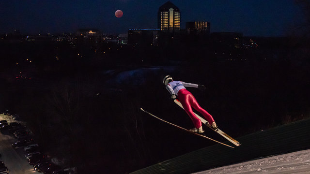 People are doing ski jump under the blood wolf moon