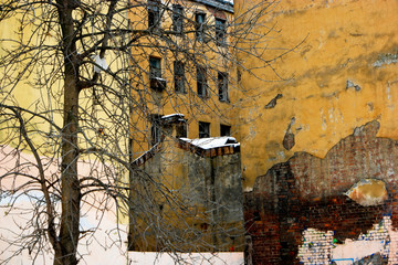 Slum and ghetto street view in winter time and snow weather with abandoned buildings Wall mural