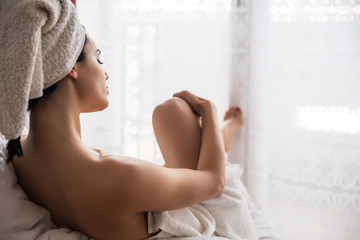 Girl wrapped in towels