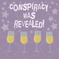 Writing note showing Conspiracy Was Revealed. Business photo showcasing the activity of secretly planned was unleashed Filled Cocktail Wine Glasses with Scattered Stars as Confetti Stemware