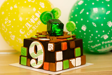 sweet, delicious bright birthday cake for 9 years, backlit in a cube of sweet green ice