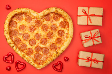 Pizza heart for Valentine's Day romantic concept on red background