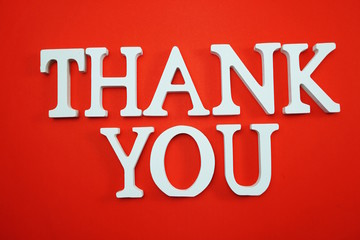Thank You alphabet letters on red background