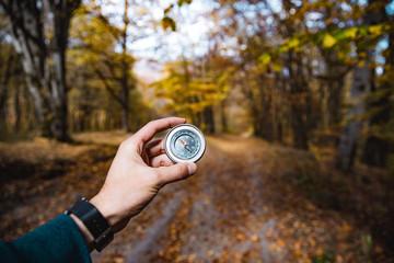 man hand compass