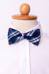 andmade bow tie on white shirts background.