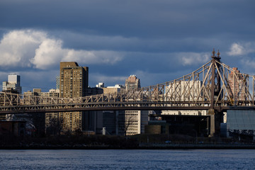 Queensboro Bridge in New York City with dramatic sky in the background