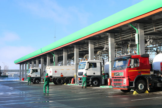 Large green industrial gas station for refueling vehicles, trucks and tanks with fuel, gasoline and diesel in the winter