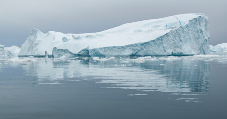 Climate Change and Global Warming - Icebergs from melting glacier in icefjord in Ilulissat, Greenland. Image of arctic nature ice landscape. Unesco World Heritage Site.