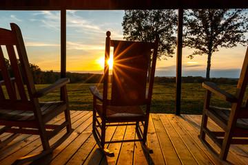 sun burst through rocking chair on front porch