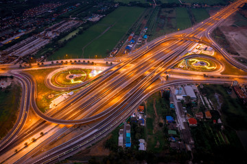 construction of a new ring road interchange and motorway expressway bypass for cars transportation  connecting the city at night in Thailand