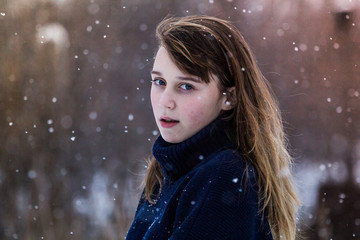 portrait of a girl in snowfall