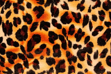 Textured background showing close up of leopard spots.