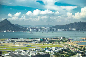 Aerial view of international airport with airplane parking in Hong Kong, China.